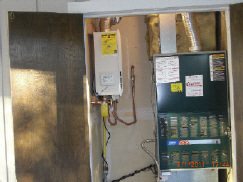tannkless water heater next to furnace