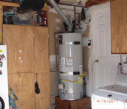 water heater near cabinets