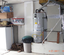 Clean water heater installation next to furnace