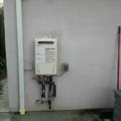 Back wall outdoor tankless water heater installation