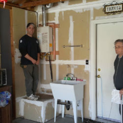 Clean tankless water heater installation in a garage