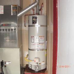 water heater leaking near furnace