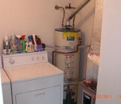 water heater next to laundry machines