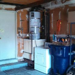 Classic water heater near washing machine