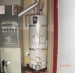 standard water heater installation next to furnace